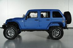 2014 Jeep Wrangler Unlimted with Kevlar Liner Finish in Laguna Seca Blue: Custom Step Rail