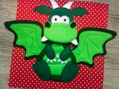Dragon on a quiet book page. Brush teeth activity.