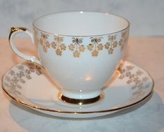 QUEEN ANNE WHITE WITH GOLD FLOWER BORDER TEA CUP AND SAUCER
