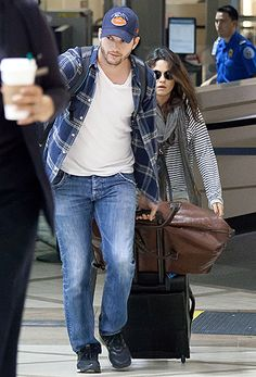 Parents-to-be Ashton Kutcher and Mila Kunis try going incognito at LAX Airport on Apr. 19