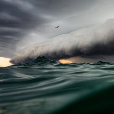 """A beautiful blanket of clouds rolls over a velvet green ocean. Could this photo be real? In fact, it is, and it was taken by photographer Jem Cresswell, who swam out to sea to capture this spectacular shot. All Nature, Amazing Nature, Science Nature, No Wave, Nature Sauvage, Wild Weather, Photo Portrait, Out To Sea, Tornados"