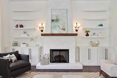 Simply stunning living room features a white plastered fireplace accented with a chunky wood ...