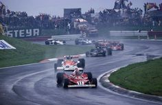 Austrian GP, 1977: Niki Lauda leads the pack from the pole. He finished second to Alan Jones, who is in the rear of this group in his Shadow-Ford. James Hunt, second here, is followed by Mario Andretti. Both suffered engine failures. Next is Hans Joachim Stuck in a Brabham-Alfa, who finished third.