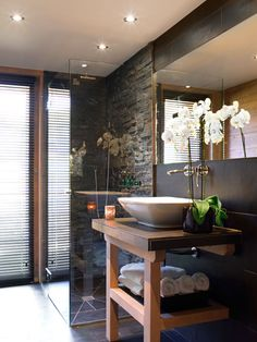 bathroom with an orchid to make it more livable and natural colors
