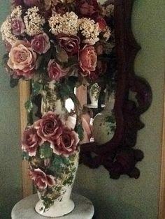 Roses in an antique rose vase.