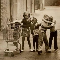 """In 1973, Joseph Crachiola was a staff photographer for a suburban Detroit, Mich., newspaper, when he spotted five kids hanging out together in an alley, giggling and having fun. """"I can't help but wonder if we couldn't all learn something from them,"""" he said this week of the photo that went viral."""