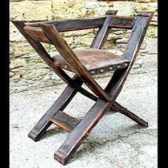 Emperor Chair. Constructed in solid oak. Hand made in the French 13th Century style. This chair features a horsehair padded leather seat in original hand tooled 17th Century leather showing the queues d'hermine.