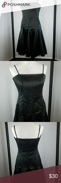 Nine West black satin cocktail dress This dress is in beautiful used condition. It has no tears, or stains. Hidden zipper is 100% functional. Pick this up at a great price just in time for the holidays Nine West Dresses Midi