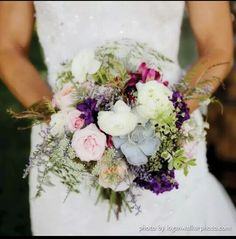 I just LOVE my bouquet!  Amy Hawke of The Flower Patch really got my vision of wild timeless romantic- with her use of White Ranunculus, Blush  and Cream Roses, a succulent, purple Delphinium, fushia Alstromeria, Queen Annes Lace, Misty Blue and beautiful greenery.  It was just spectacular!!