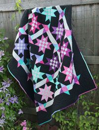 Midnight Stars by Lerlene Nevaril in Best Fat Quarter Quilts 2014.