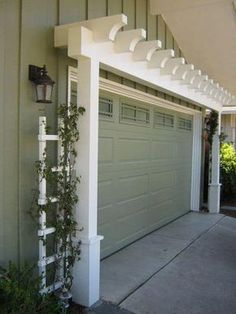 146578162845945372 Garage Door Arbor great way to increase curb appeal is with an arbor over the garage door. A manual post hole digger i. by cecelia House Paint Exterior, Exterior House Colors, Exterior Doors, Exterior Design, Diy Exterior, Garage Exterior, Exterior Makeover, Garage Door Design, Garage Doors