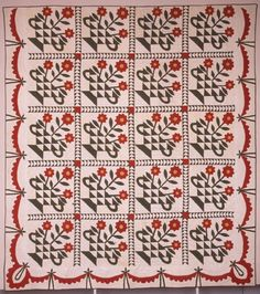 """Antique Flower Basket quilt, mid-nineteenth century, 84.5 x 95.5"""".   This basket pattern is tied together by an inner Wild Goose Chase sashing and is bordered with a serrated swag and ties. From an exhibition held at the Woodrow Wilson Birthplace and Museum during the spring of 1995"""