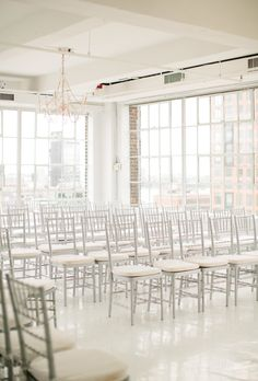Silver chairs at Studio 450. Event Planning: Roey Mizrahi Events | Floral Design: Blade Floral And Event Design. Photography: Lindsay Madden.