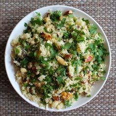 Couscous salad with fresh herbs, crunchy nuts and a pungent cardamom dressing.