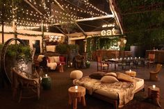 """Hudson Lodge, an """"outdoor urban ski resort-themed bar,"""" in the private park/terrace inside the Hudson Hotel of NYC."""
