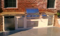 Custom outdoor kitchen with granite counters stucco front and stone by the bar. | Jobs done by ...
