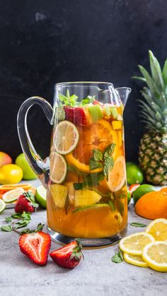 This Pineapple, Mango, Strawberry and Green Apple White Wine Sangria recipe is featured in the Spring and Summer Cocktails feed along with many more. Summer Cocktails, Cocktail Drinks, Alcoholic Drinks, Beverages, Pina Colada, White Wine Sangria, Mango Sangria, Sangria Pitcher, Red Wine