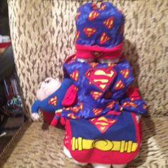 Superman diaper cake Diaper cakes are not just gifts for baby shower anymore Includes  Superman beanie hat Superman bib Superman doll Superman onesie Superman booties Diapers  Will b wrap in plastic with ribbon Other