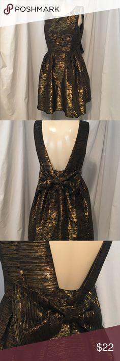 She Sky black and gold metallic dress Black and gold dress. Fit and flare, low back with bow She and Sky Dresses