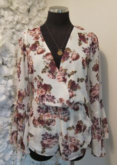 Floral romper with bell sleeves!! $55