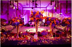 Rich purples and orange wedding reception
