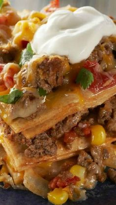 Easy Baked Taco Pie ~ Here's everything you love in a taco—from the ground beef and veggies to the dollop of sour cream on top—all in one easy, baked pie.