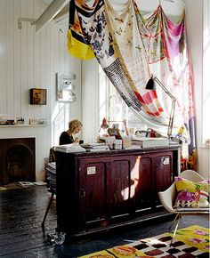 Love the use of draped fabric to designate a work area. it's a clever way to make use of given architecture, and really adds dimension to a small space as much as a large space by creating long, linear lines.