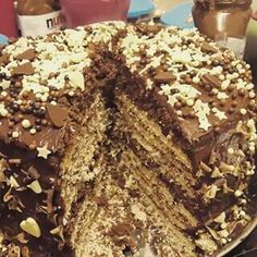 8 layer monster cake.  Each layer filled with a different surprise.  Layers of ore Ferrero rocher kinder Bueno crushed malteasers crushed  jaffa cakes fudge brownies topped with chocolate and sprinkled with white dark and milk chocolate pieces at #Teddylicious in Tipton
