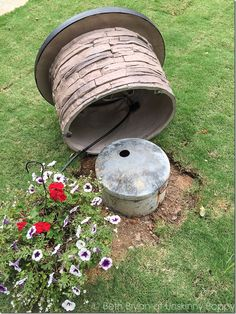 hide the lid of a buried propane tank with a rock fire table - Garden Ideas To Hide Septic Tank