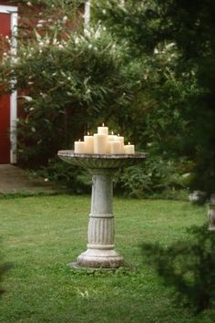 Old bird bath into huge candle holder.love! Lovely around a patio..at a wedding...