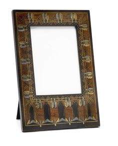 CARLO BUGATTI standing picture frame, model no. 36, c. 1900, rosewood with ebony, pewter, brass inlays, glass, suede, 24.4 x 16.8 cm | SOLD $5,625 Sotheby's New York, June 13, 2012