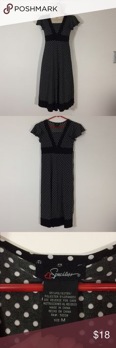 Black and white polka dot dress Euc, no holes or stains. Adorable midi length. Empire waist and ties in back. Stretchy and comfortable. Speechless Dresses Midi