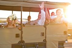 Bridal party on a game drive having fun