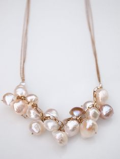 L O V E! She's amazing! Wire Wrapped Cluster Pearl Necklace by KenjJewelryDesigns on Etsy (beautiful designs)