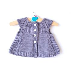 This charming cap-sleeved, swingy cardigan is the perfect timeless piece to add… – Baby knitting patterns Baby Knitting Patterns, Knitting For Kids, Baby Patterns, Crochet Patterns, Aran Weight Yarn, Seed Stitch, Baby Sweaters, Baby Dress, Cap Sleeves