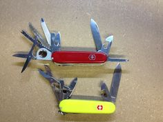 My two favorite Victorniox Swiss Army Knives (SAKs) the Climber (yellow) and the vintage Victorinox Champion