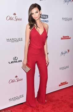 Red hot: Emily Ratajkowski went for a typically eye-catching red playsuit as she arrived at the Sports Illustrated swimsuit edition party in New York