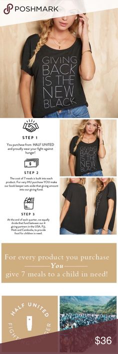 """Buying this provides 7 meals to a child in need! Giving Back is the New Black - Tee! - Helping people is cool! HALF UNITED founded in 2009 has provided over 500,000 meals for children in need! Dolman cut tee designed by Aly Silverio of """"Jawbreaking."""" Cotton/poly/rayon blend.  For every product you purchase, YOU provide 7 meals for a child in need!  https://youtu.be/k11zDHJCBqE Half United Tops Tees - Short Sleeve"""