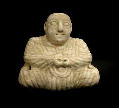 Bactria-Margiana Squatted Figurine - Origin: Turkmenistan Circa: 2100 BC to 1800 BC Dimensions: 4.25 (10.8cm) high Collection: Near Eastern Medium: Marble