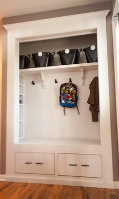 Mudroom Closet Reveal... kinda love this instead of the entry way closet