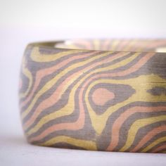 Tri-gold mokume gane in yellow, red and white. By Chris Ploof.