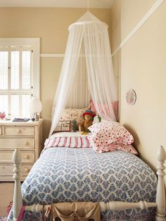 A gauzy, ceiling-hung canopy is a nice little-girl touch -- not only does it give this twin bed princesslike appeal, it also adds interesting height to the corner of the room.  Simple, casual furnishings in neutral hues allow your little girl's decorating style to change easily as she grows.