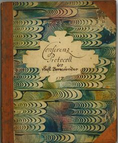 Minutebook of the 1770s Anstaltsvormünder conferenz (Committee of Moravian School Directors); from the Moravian Archives. The decorated paste paper was a specialty of Moravian women in the Single Sisters' houses.