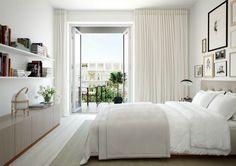 Een dressoir in de slaapkamer staat erg mooi, ladenkasten over de hele wand tegenover het bed bieden extra opbergruimte en styling ruimte.