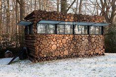 Hilversum,The Netherlands,   log house on wheels as study for music-entertainer Hans Liberg.  design by Piet Hein Eek