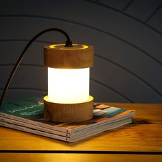 Large Jojo table lamps and bedside lamps offer atmospheric light levels when you want to be gently illuminated. Made from Oak and a frosted translucent layer of acrylic the G9 LED bulb is included.