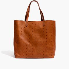 What goes into the playful perforated version of our signature tote? Here it is by the numbers: 2 pieces of rich leather are used for the body. Hundreds: of cool diamond hole punches, perfect for personalizing with pins. 8-inch strap drop: long enough to sling over your shoulder but short enough to hold as a top handle. 1 interior side zip pocket to keep your keys, phone and wallet at the ready. 24: the number of hours in a day that this bag looks cool. How often you'll reach for it? 500 ...