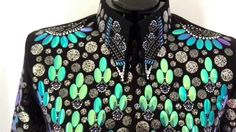 Ladies Iridescent Western Show Jacket. We've used our amazing glossy iridescent color-changing elements for this stunning new jacket. The ovals reflect purple to blue to turquoise to green depending on angle and light. The jacket looks all deep blue at times and all shades of green at others. Really a dynamic look! https://lisanelle.com/products/color-changing-iridescent-western-show-jacket