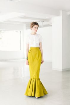 Great mermaid silhouette on this intensely yellow skirt.