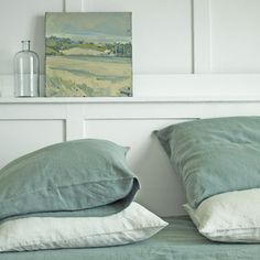 The bluish-green of the painting and the bedding would look great in either my bathroom or bedroom.